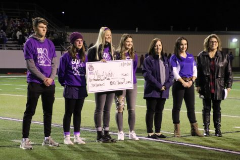 NPHS Student Council presents the donation check of 10,000 dollars to the Make-A-Wish foudnation.