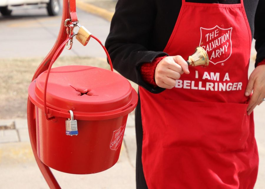Bell+ringers+stand+next+to+the+red+kettle+to+collect+money.+%E2%80%9CThe+money+raised+supports+our+operation+or+ministries+all+throughout+the+year%2C%E2%80%9D+Poff+said.