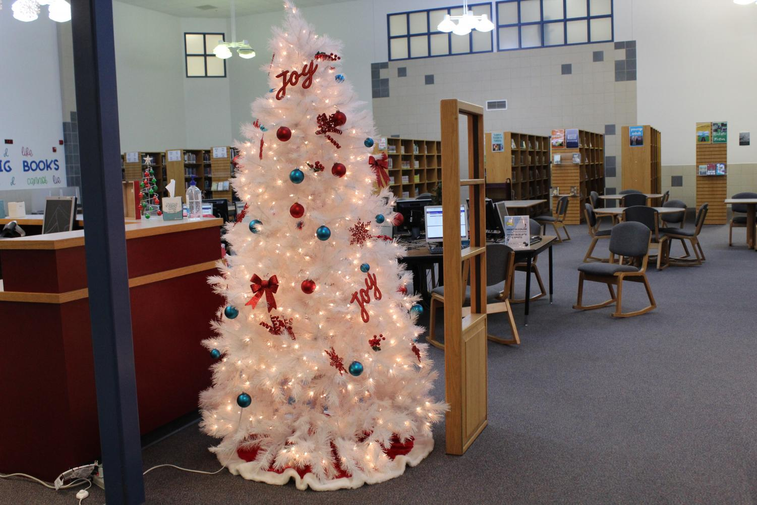 NPHS' librarians set up decorations. They had up too four trees in the library. There were also elves hidden in the books.