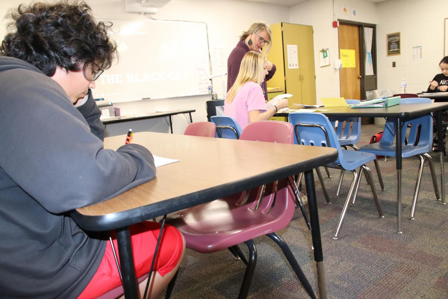 An Adams Middle School student sits in a near-empty classroom. On Nov. 25, only seven students attended this class.