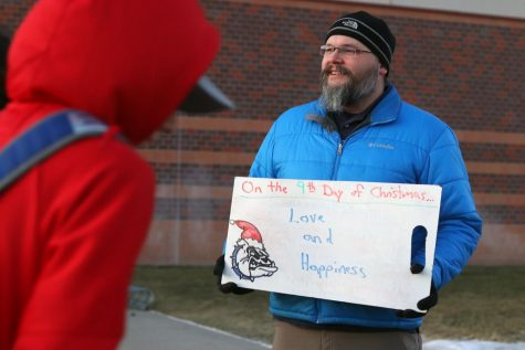 Science teacher Scott King greets students in front of the school on Monday, Dec. 9. Monday's theme is always