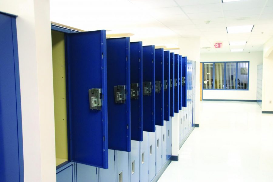 A+wall+of+lockers+sits+completely+abandoned+in+the+1300+pod+of+NPHS.+Students+commonly+leave+their+lockers+empty+throughout+the+year.+%22I+think+the+only+dramatic+change+would+be+if+we+said+no+backpacks%2C%22+principal+Scott+Siegel+said.+