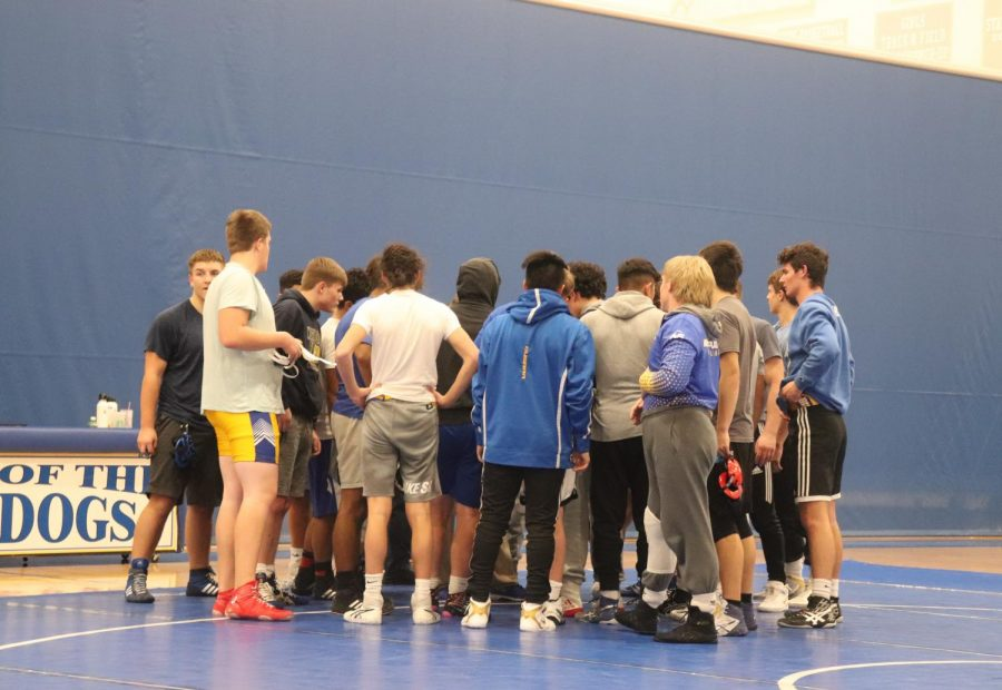 The+NPHS+wrestling+was+called+to+join+together+on+Dec.+3.+The+team+quickly+gathers+before+they+all+wrestle.+All+the+coaches+talk+to+them+giving+advice.+