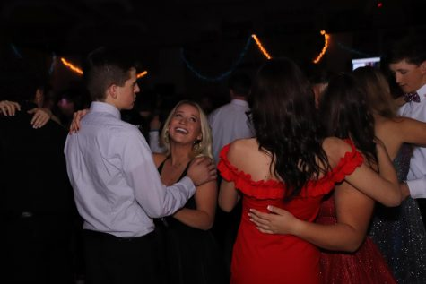 A group of couples dance to slow song at the 2020 snowball dance.