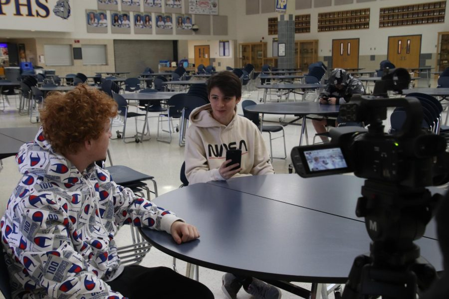 Junior Hayden Thatcher and Senior Juan Zanguitu work together to get the videos they need for their project.