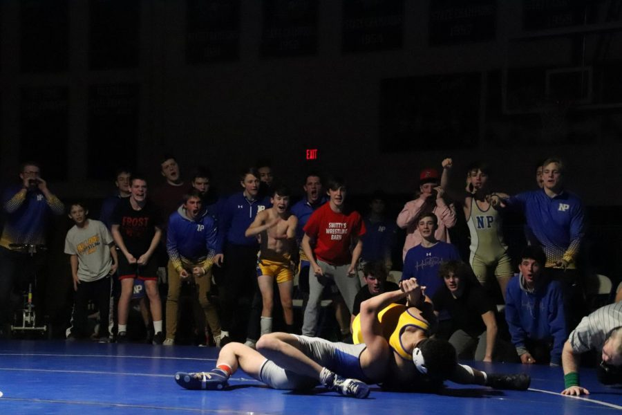 The+wrestlers+show+excitement+as+they+cheer+on+junior+Jaylan+Ruffin.