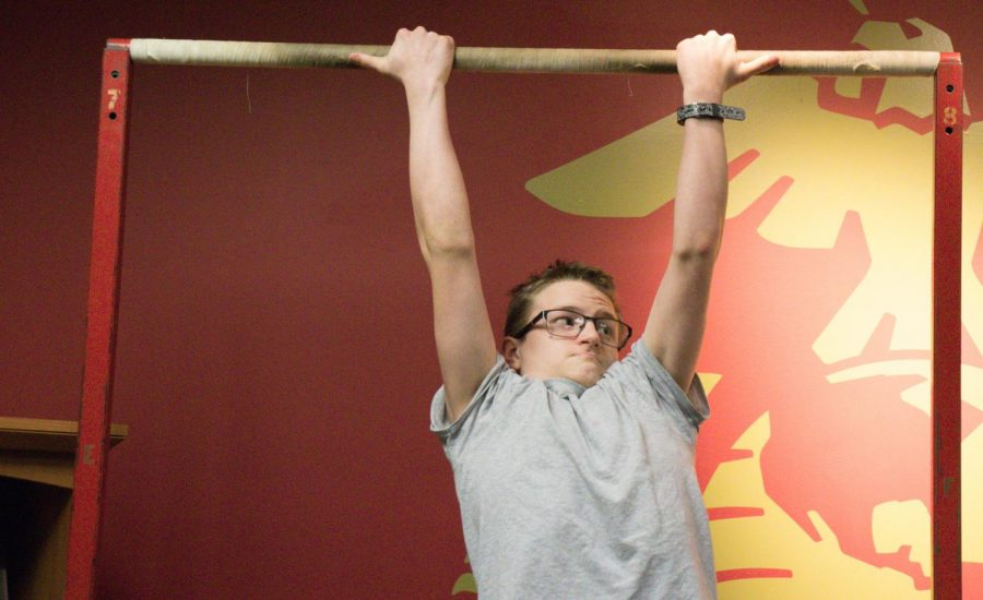 Freshman Austin Underwood does pull-ups at a Marine workout on Jan. 23. These workouts help to prepare young men and women for boot camp.