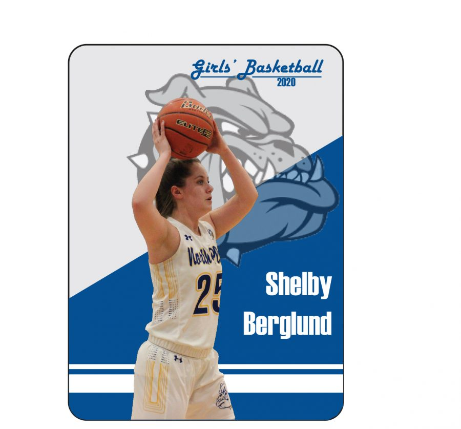 Senior Shelby Burgland passes an over head to her team mate while playing against Columbus.