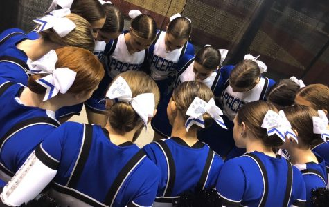 The Pacer dance team huddles to pray at state dance.