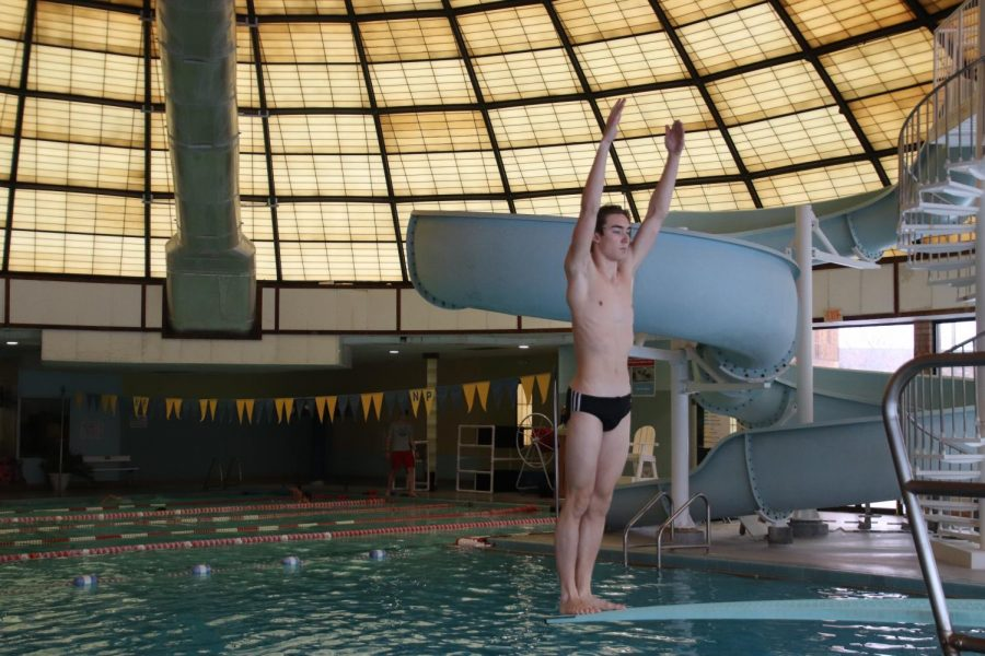 Junior Jonathan Brouillette practices his dives for State. The competition is taking place on Feb. 27. This is Brouillette's third year competing at State, after a sixth place finish last year.