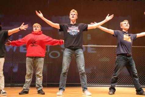 "Freshman Uriel  Wiezorek, sophomore Cade Davis, senior Joel Bradley, and junior Caedmon Hoaglund practice ""The Jet Song"" for ""West Side Story."" The musical premiers on Mar. 13, 14, and 15. The musical is being choregraphed by senior Ciera Carlson."