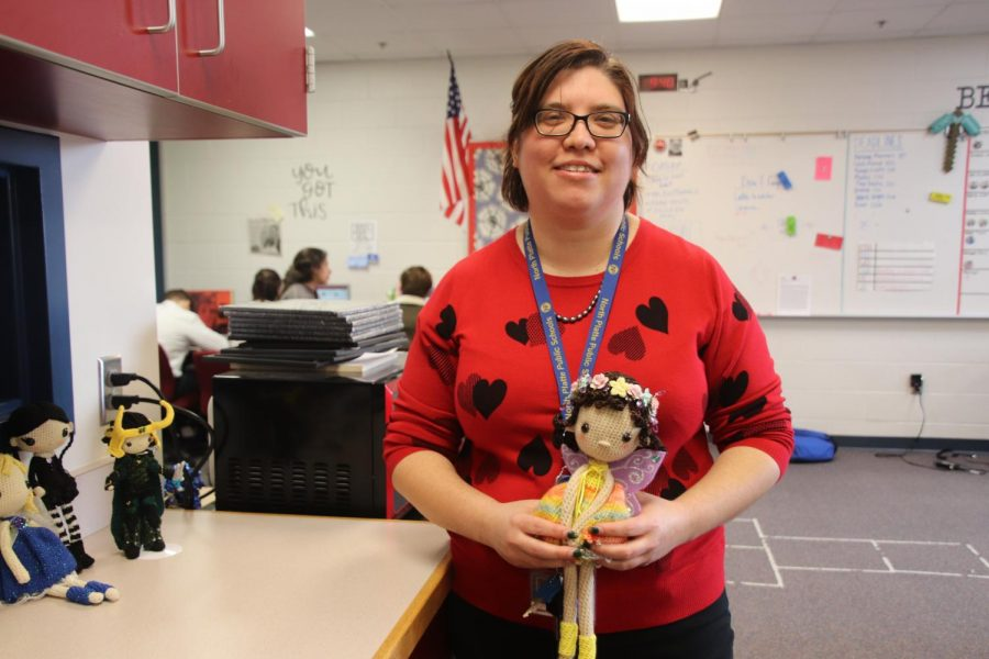 English teacher Jennifer Long holds a doll that she crocheted by hand.
