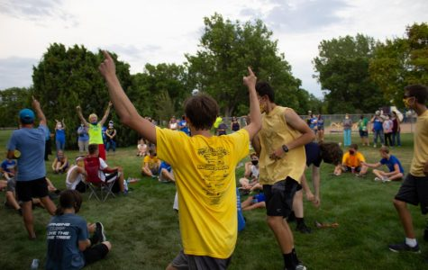 Senior Aaron Franz celebrates his team winning in the Blue, Gold, White Cross Country Scrimmage. According to Franz, being a senior in these times are a little scary.