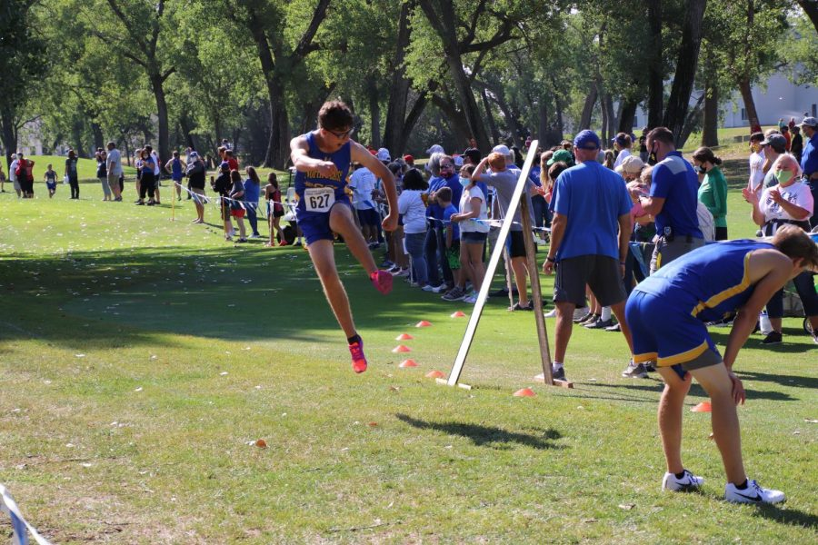 Sophomore Oban Sandoval celebrates his new personal record at the finish line on August 29. Sandoval got a time of 20:19.32.