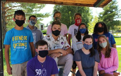 North Platte Bulldogger staff poses for a picture on the first day while wearing masks.