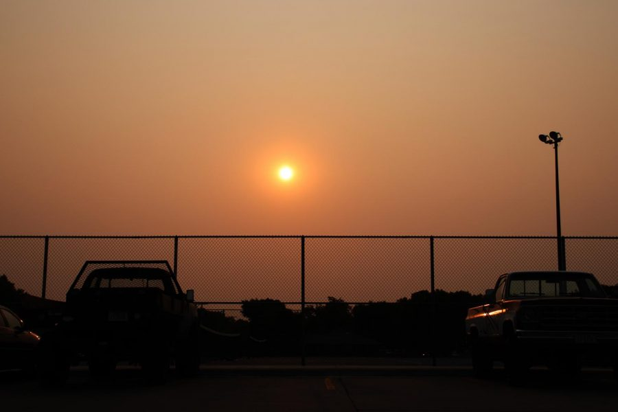 Smoky haze from California wildfires block the sunrise before school on Sept. 17.