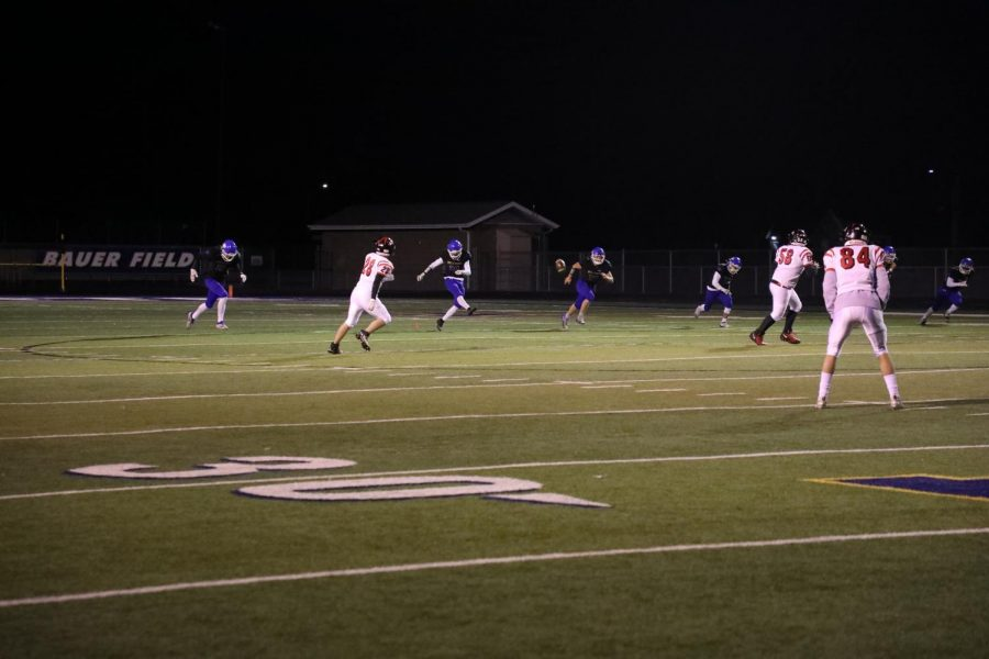 Senior Jaden Dike kicks the ball off in the fourth quarter against Lincoln High on Oct. 23 at North Platte High School.
