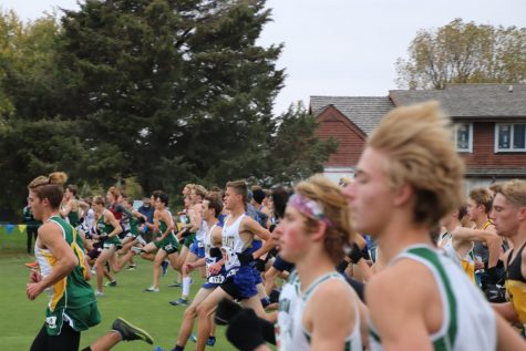 "Senior Aaron Franz and Junior Evan Caudy (middle) begin their final race of the season at the boys' Class A state competition on Oct. 23 in Kearney. Throughout the season, runners worried that the season could be cancelled at any time. ""There were a lot of uncertainties this year with COVID, "" said coach Jake Hasenauer. ""We just didn"