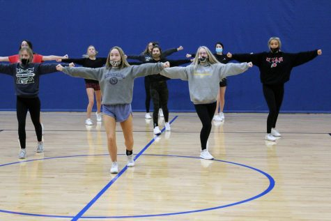 Cheer captains Haeley Folk and Lauren Ginn perform during their 6:15 a.m. practice with their team on Nov. 11.