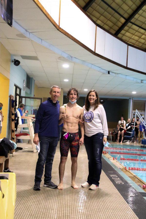 Senior Kris Kautz gets recognition at swim and dive senior night.