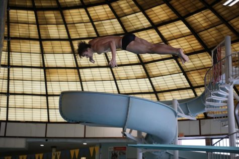 Senior Jonathan Brouillette performs at the home meet at the Recreation Center on January 28.
