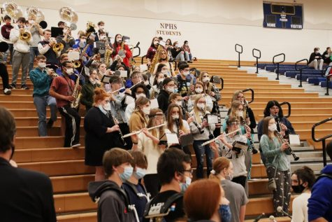 The pep band plays at a pep rally. Students have recently been let back into sporting events, so the band has as well.