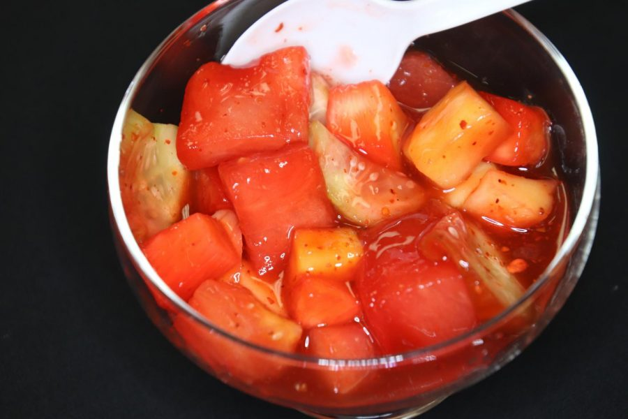 A close up of the mexican fruit cup with chamoy and tajin.