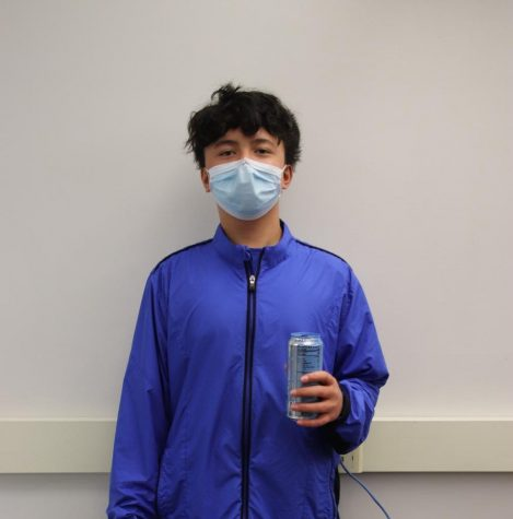 Sophomore Tony Booth poses in his blue outfit to match his energy drink.