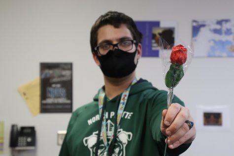 Arts and Entertainment editor Nathenial Crow poses with a rose.