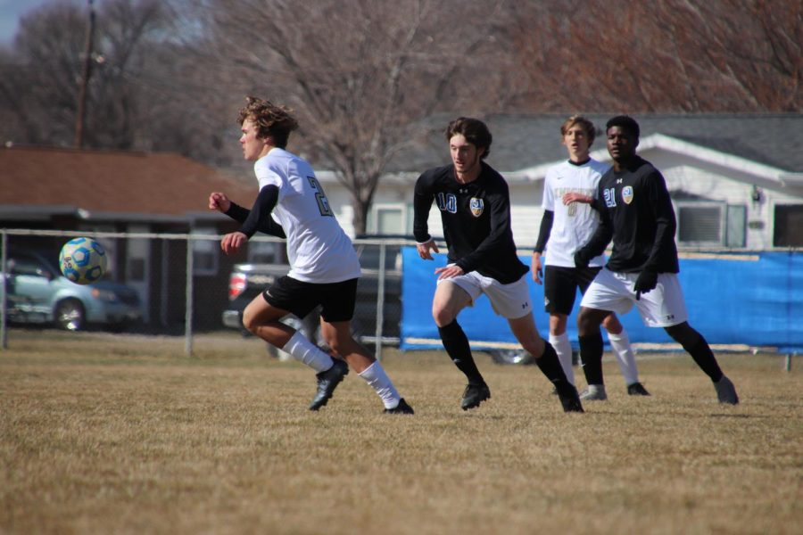 Junior Ty Hilderbrand runs after the ball during their match against Lincoln Southeast on March 18th.