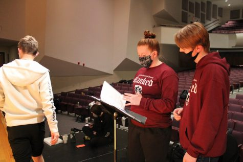 Brittney McDaniel helps senior Nathan Morris with his part in the musical Ranked during their practice.