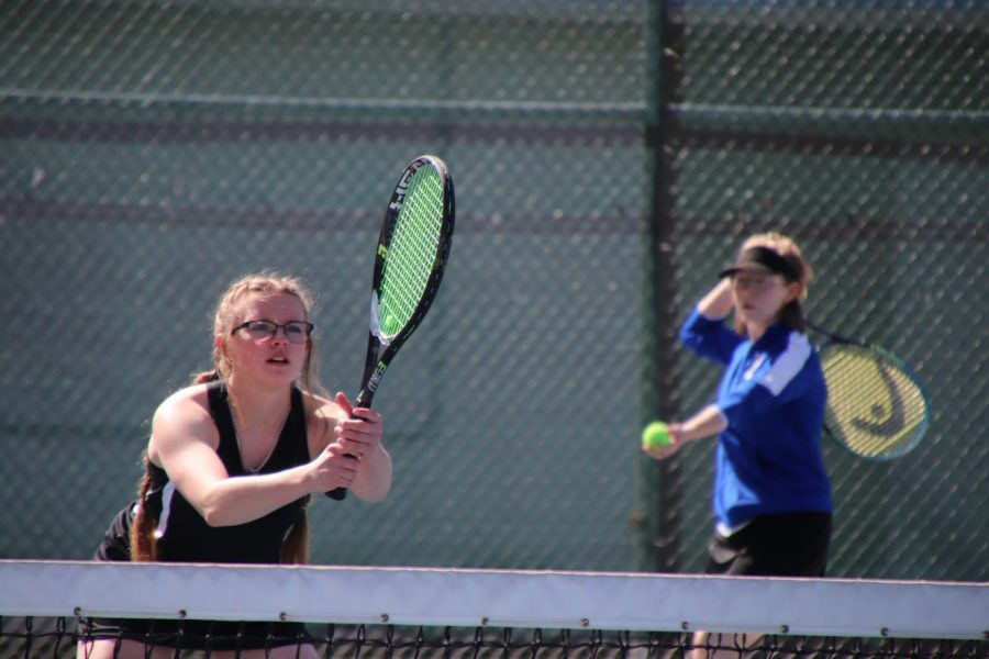 Number one girls' double team competes at NPHS invitational. Seniors Brianna Plaster and Samantha Bowers prepare to start their first match of the day.