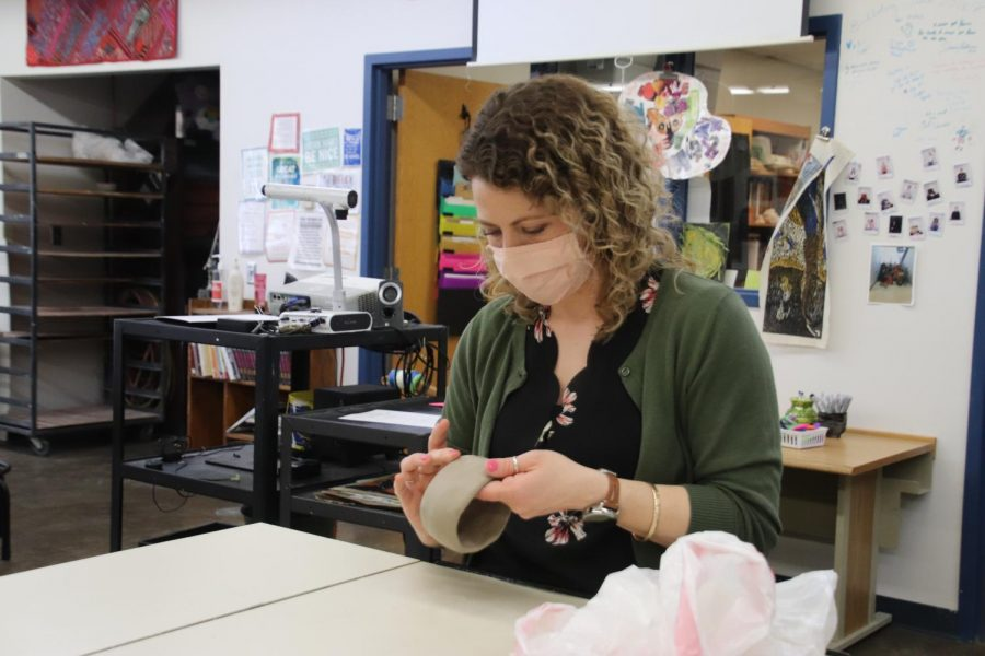 Joy DeVoe demonstrates how to create a pinch pot for her art class.
