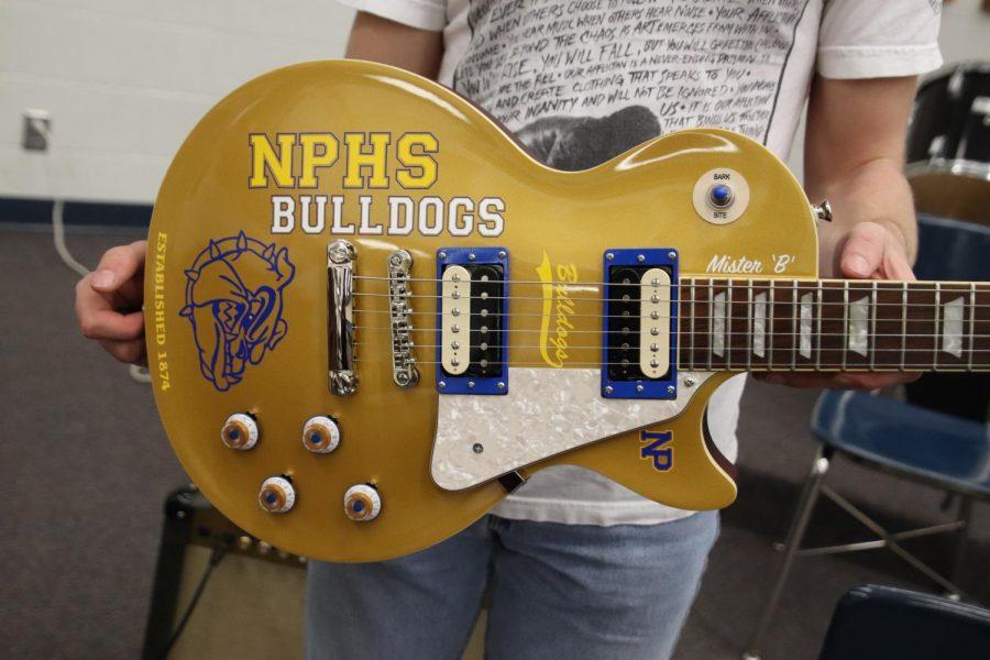 Junior Jack Bunger holds the awarded, bulldog inspired  guitar.