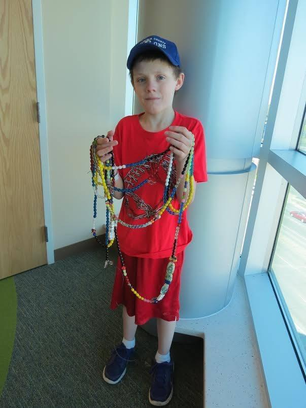 The beads in this picture represent everything Darin went through while having cancer treatment. Each bead represents something different. Red is blood transfusions, white is hospital stays and yellow is chemo. There are different beads for radiation, scans, blood draws and out patient stays that arent in that specific string of beads.
